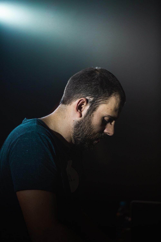 man wearing blue T-shirt