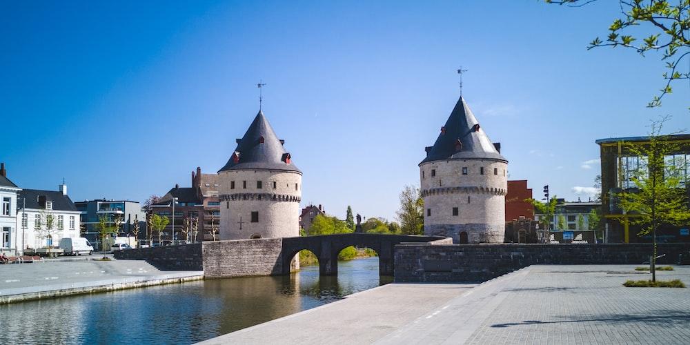 two gray concrete castles near bridge