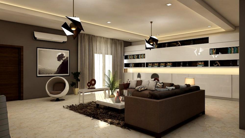 rectangular white coffee table near brown leather sofa