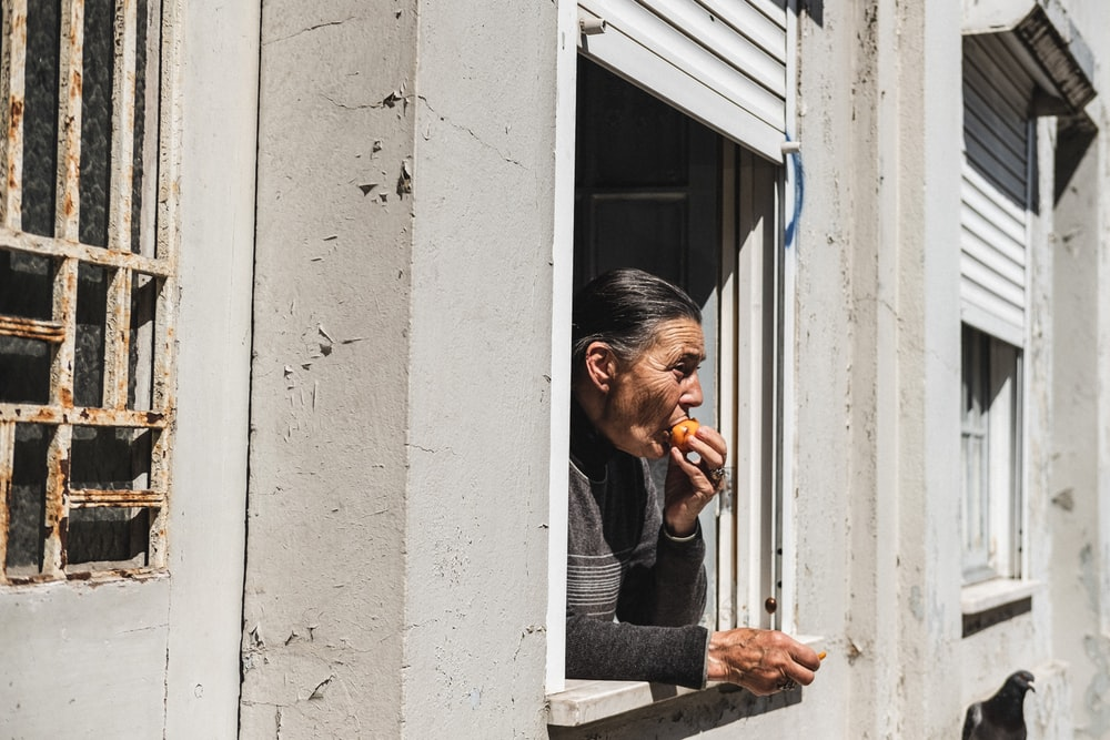 man eating food at the window