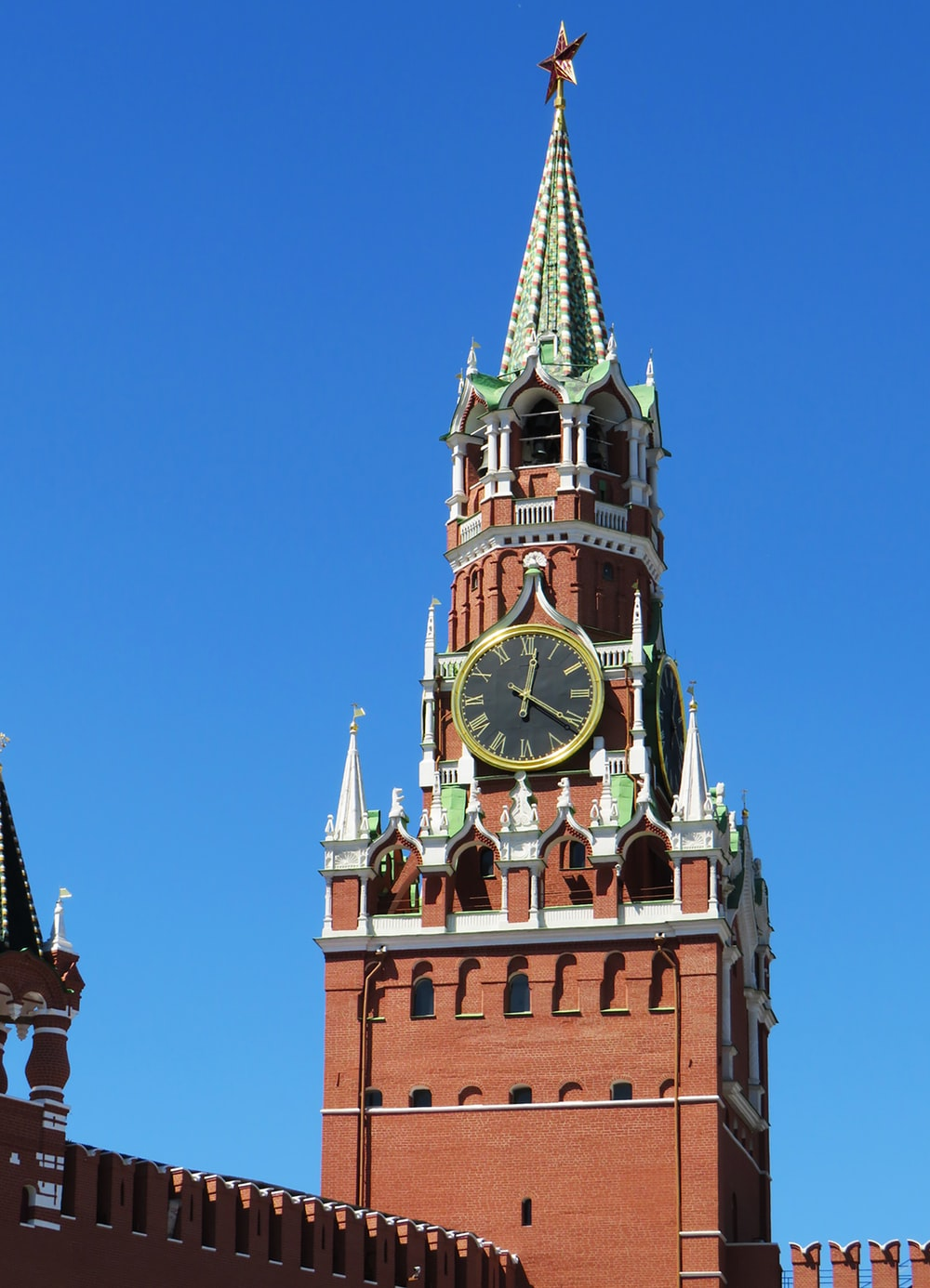brown, green and white clock tower