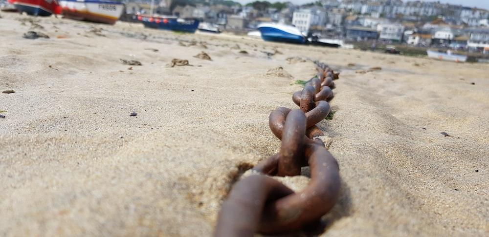 black metal chain on brown sand