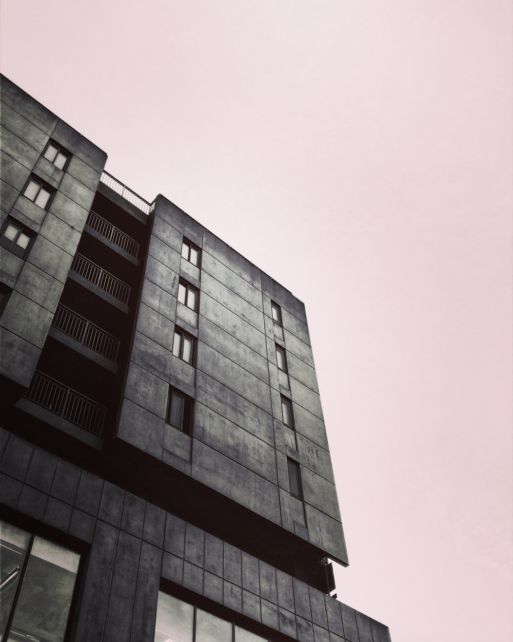 grey high rise building low angle photo