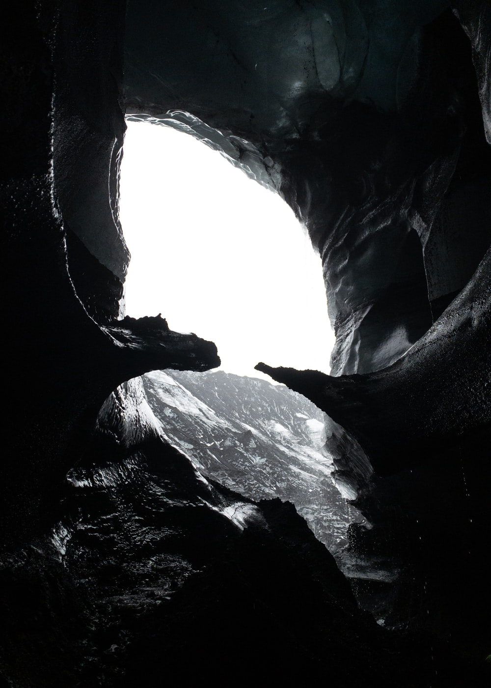 grayscale photography of cave