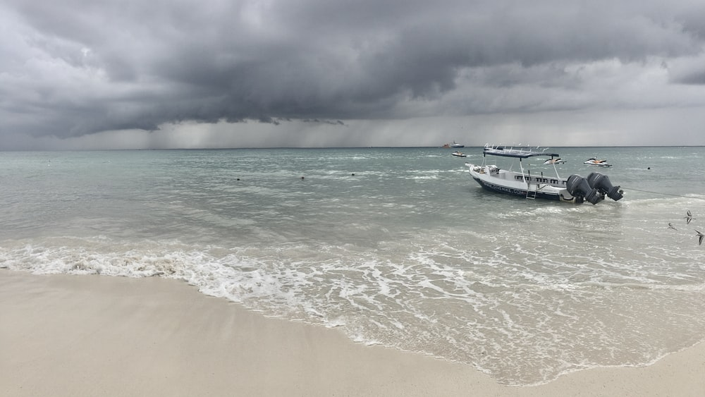 white boat on seashore