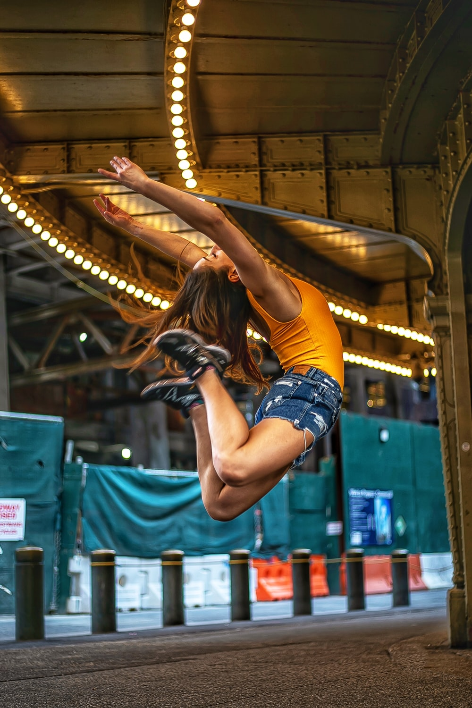 jumping woman under light
