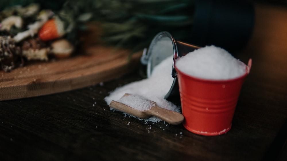 white powder in red metal bucket