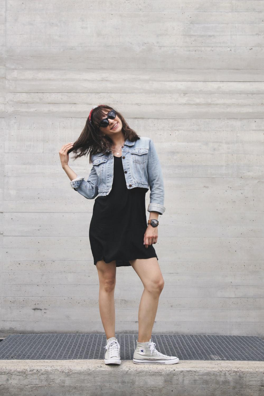 woman in black dress and blue denim jacket