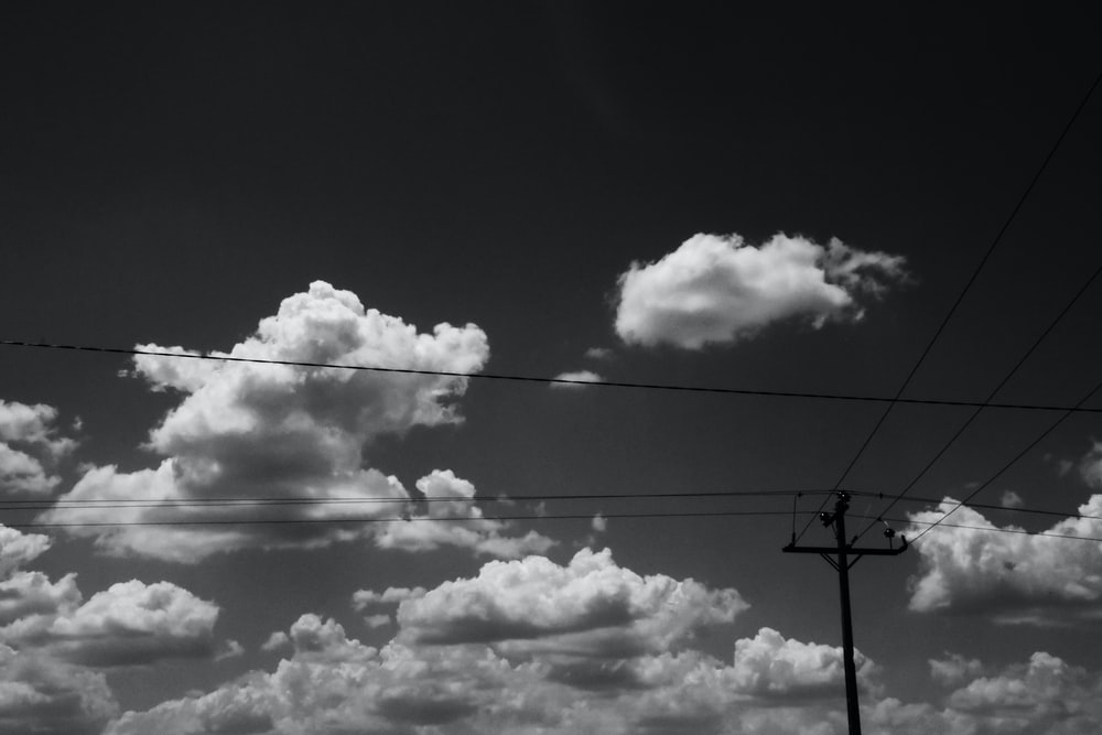 street post under cumulus clouds