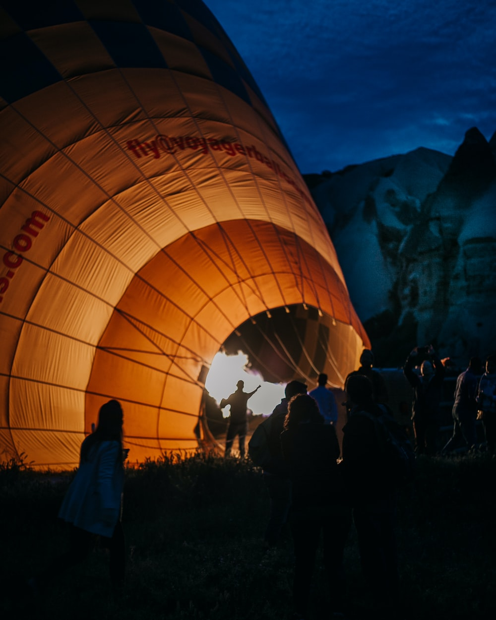 people standing on hot air balloon