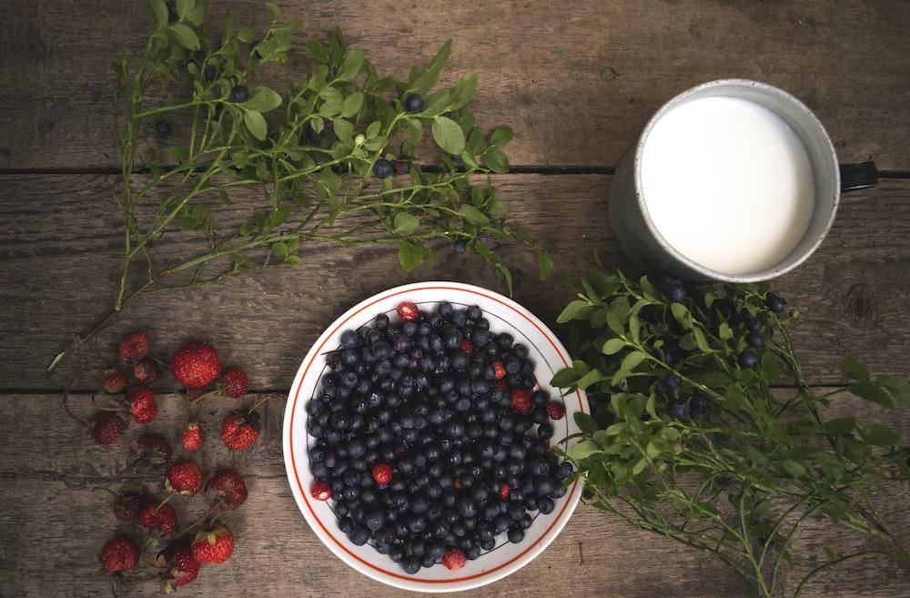 black berries in round white ceramic plate