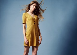 standing woman wearing yellow top