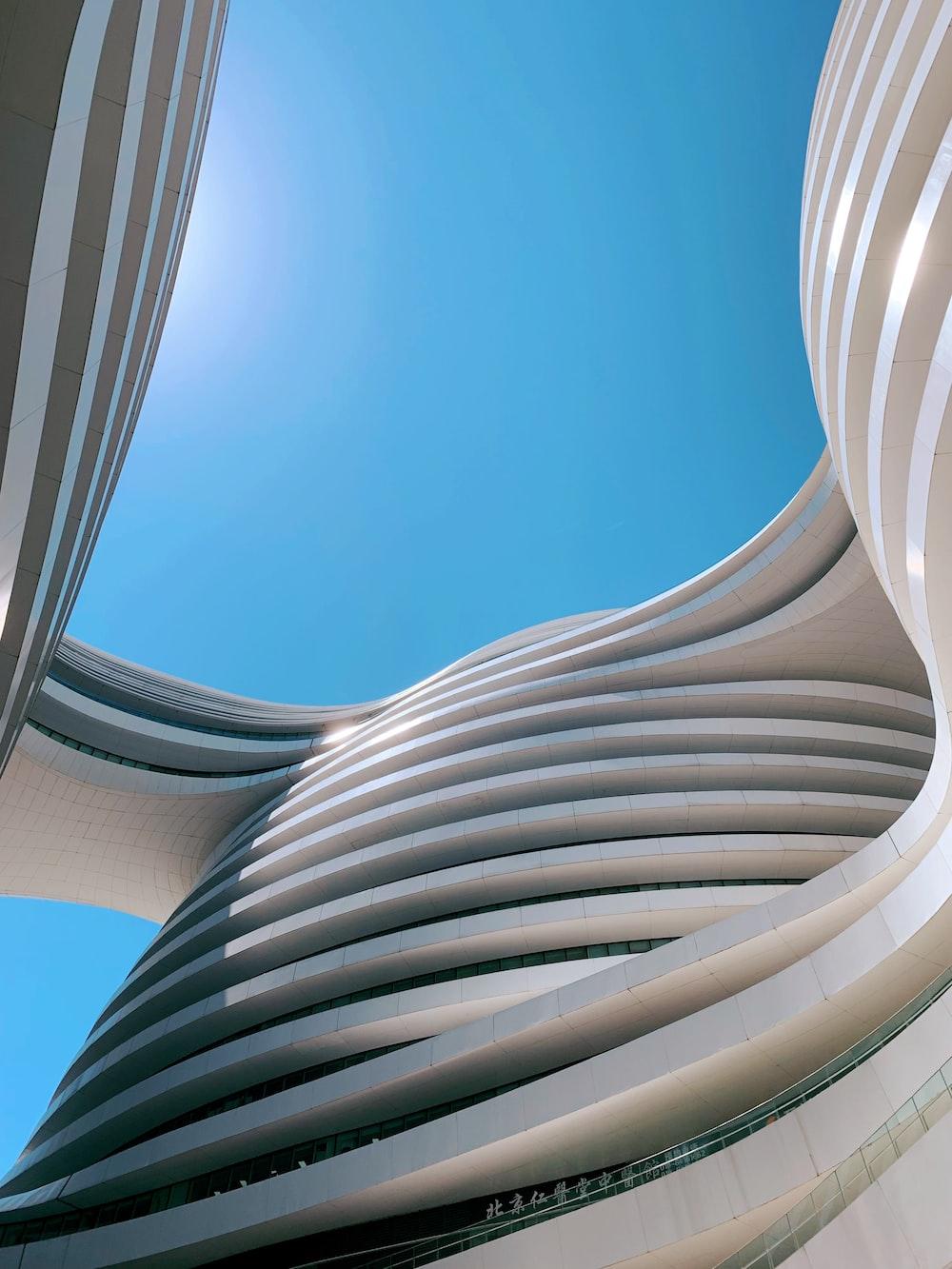 white concrete building under blue skies