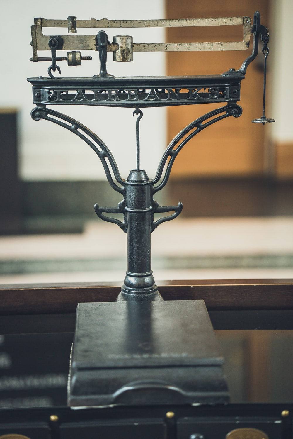 grey antique weighing scale on table