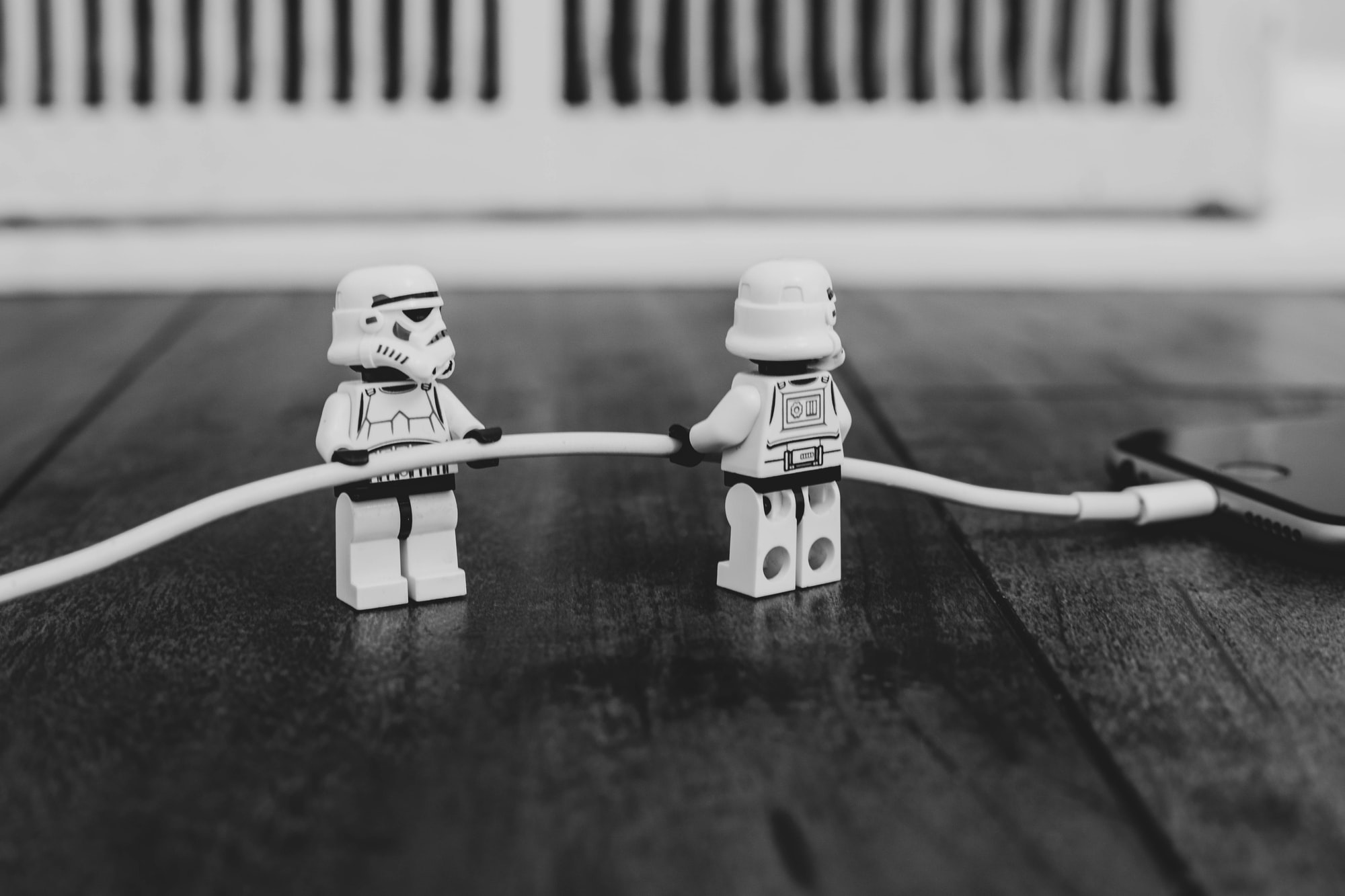 Storm troopers collaborating to charge an iPhone