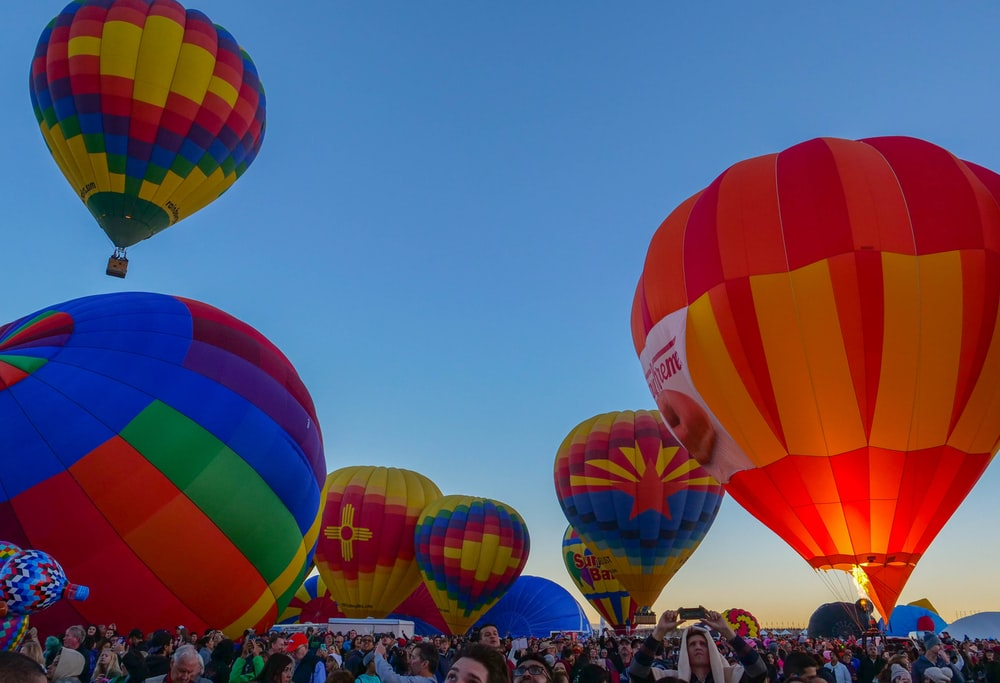 bunch of hot air balloons flying on sky