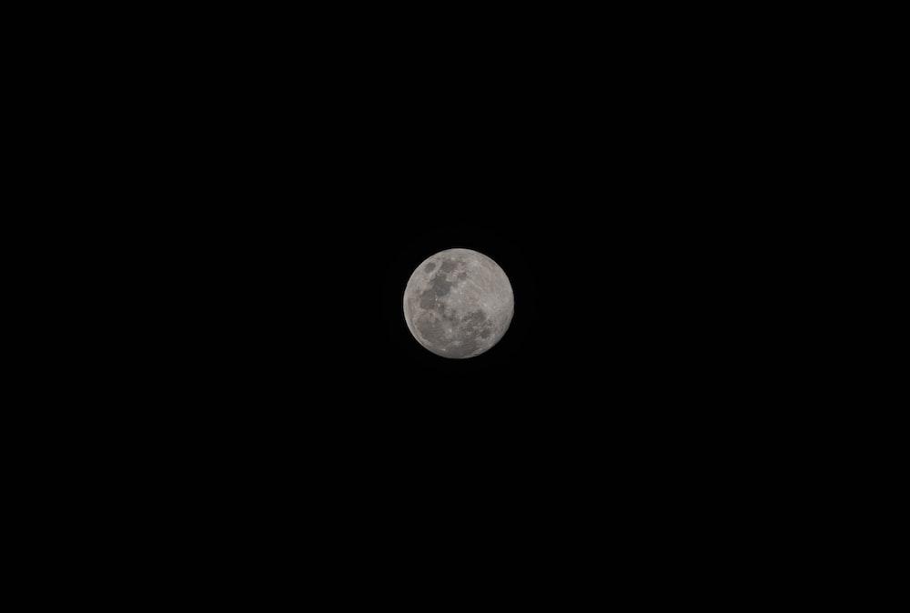 grey round full moon on night sky
