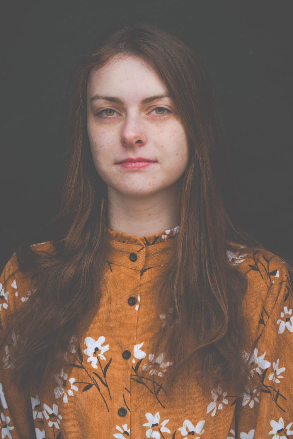 woman in brown,white and black floral blouse