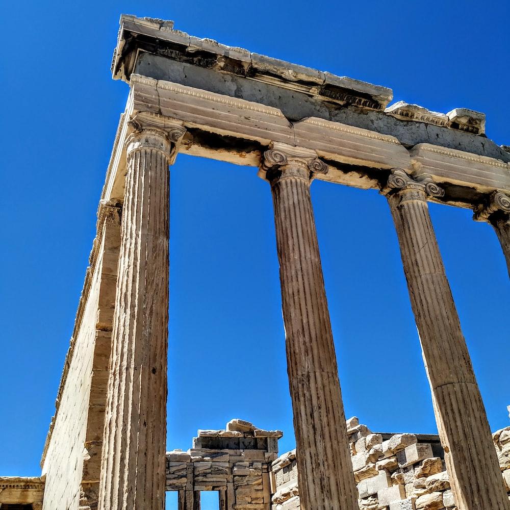 brown pillars ruins under clear blue sky