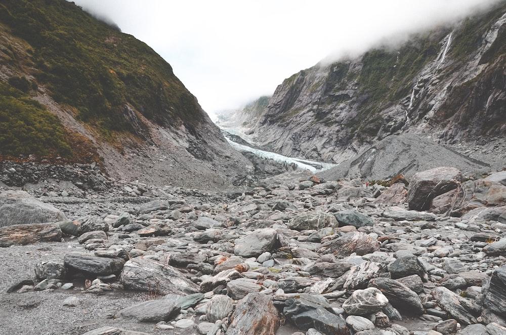 gray rocks near mountain