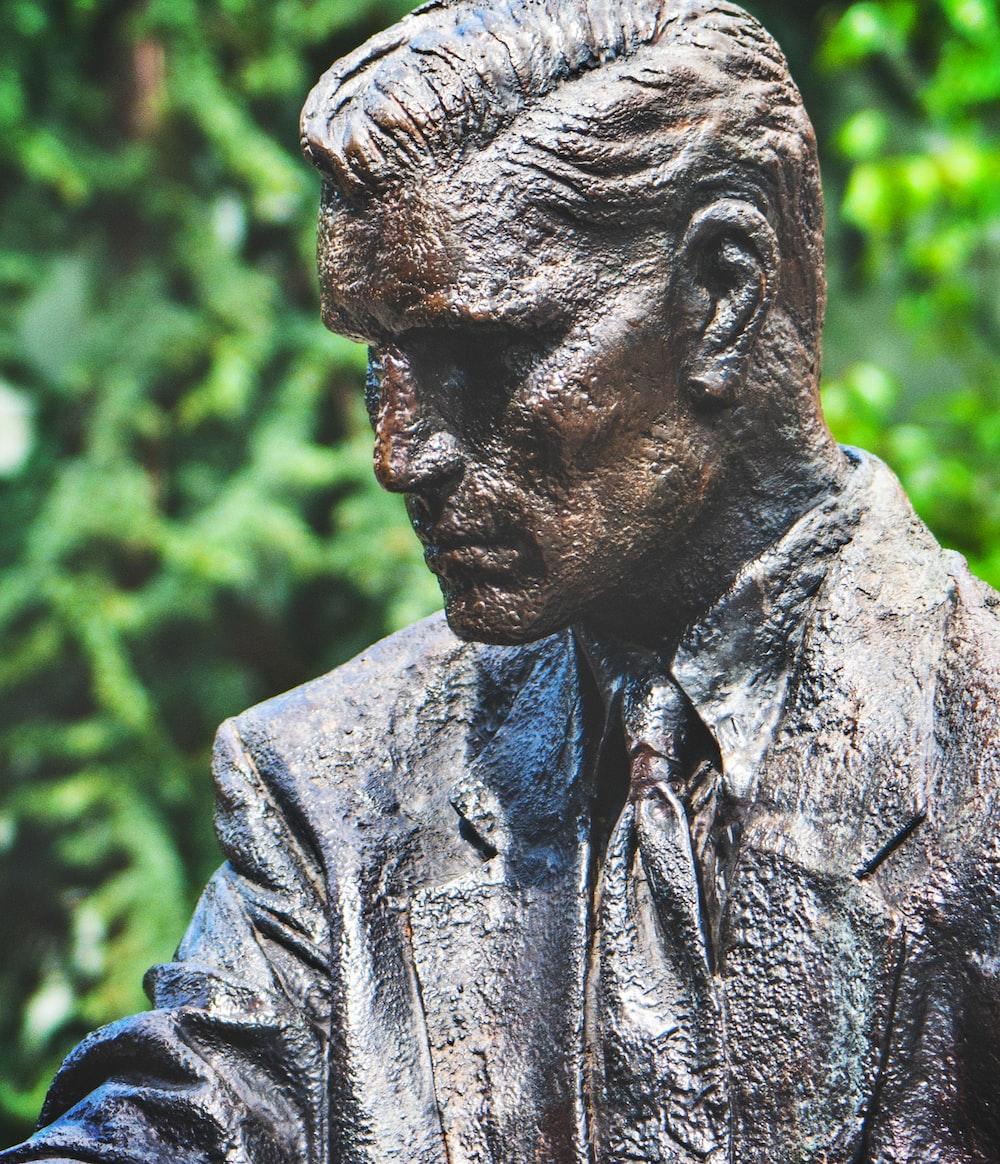 grey statue of man