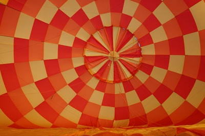 pink and white textile hot air balloon teams background