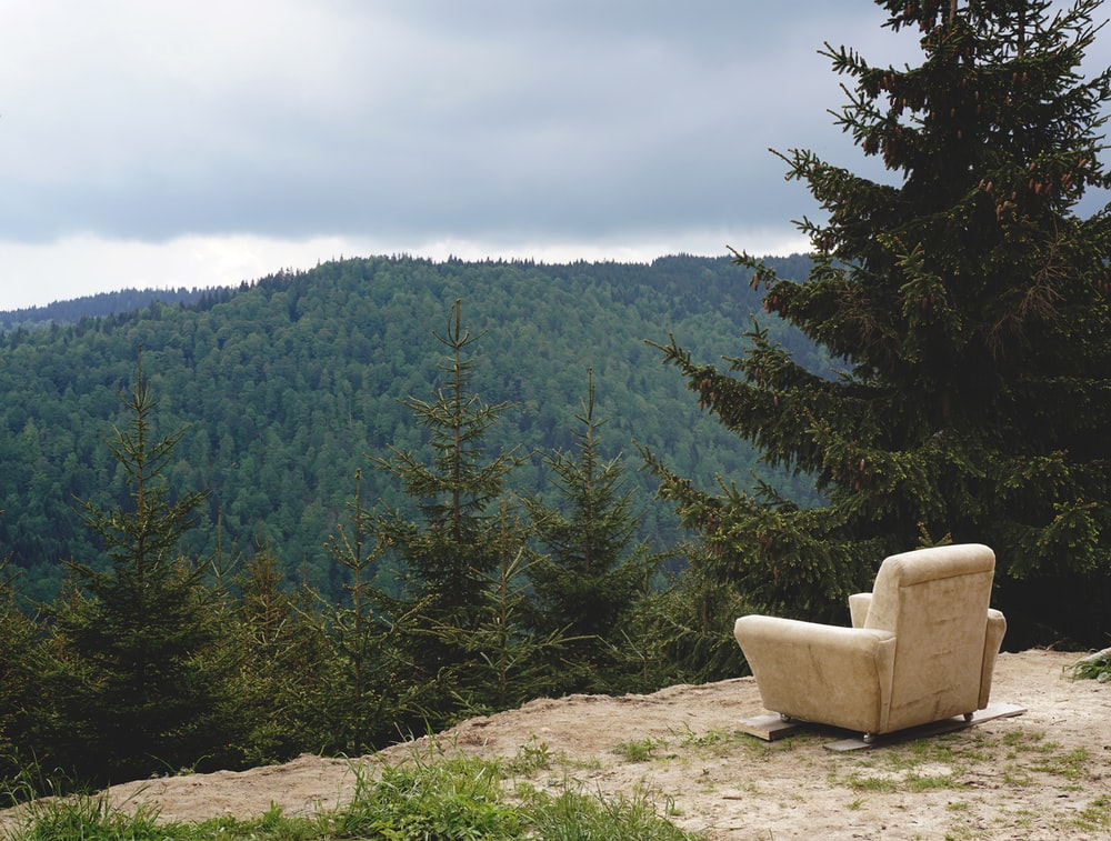 gray fabric sofa armchair in mountain during daytime
