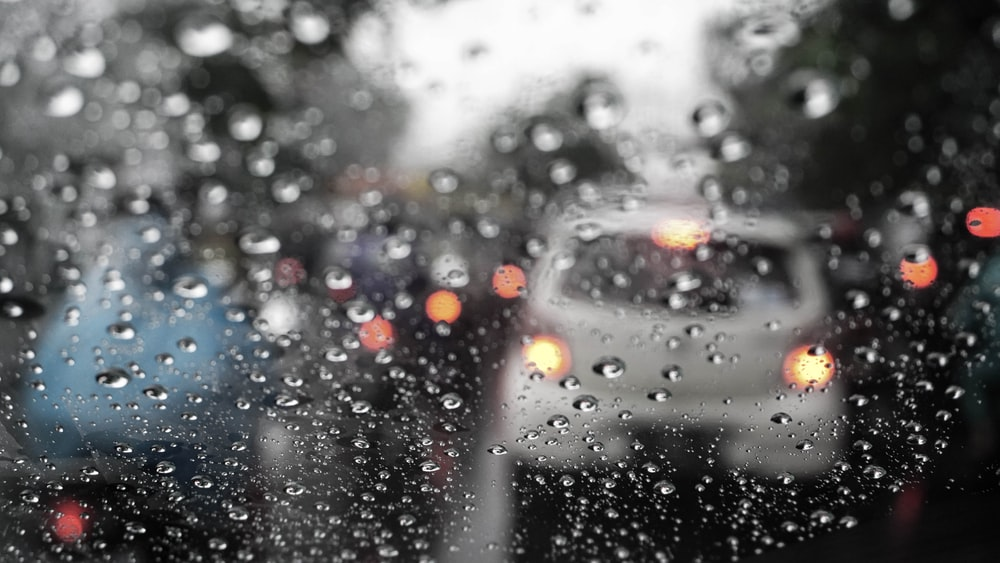 cars on traffic with water dew