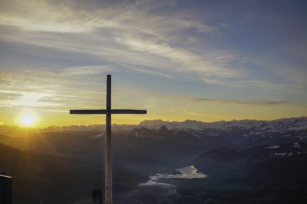 brown cross on mountain