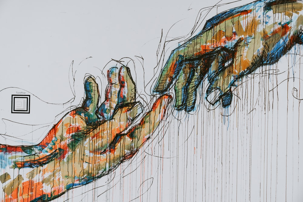 two human hands painting