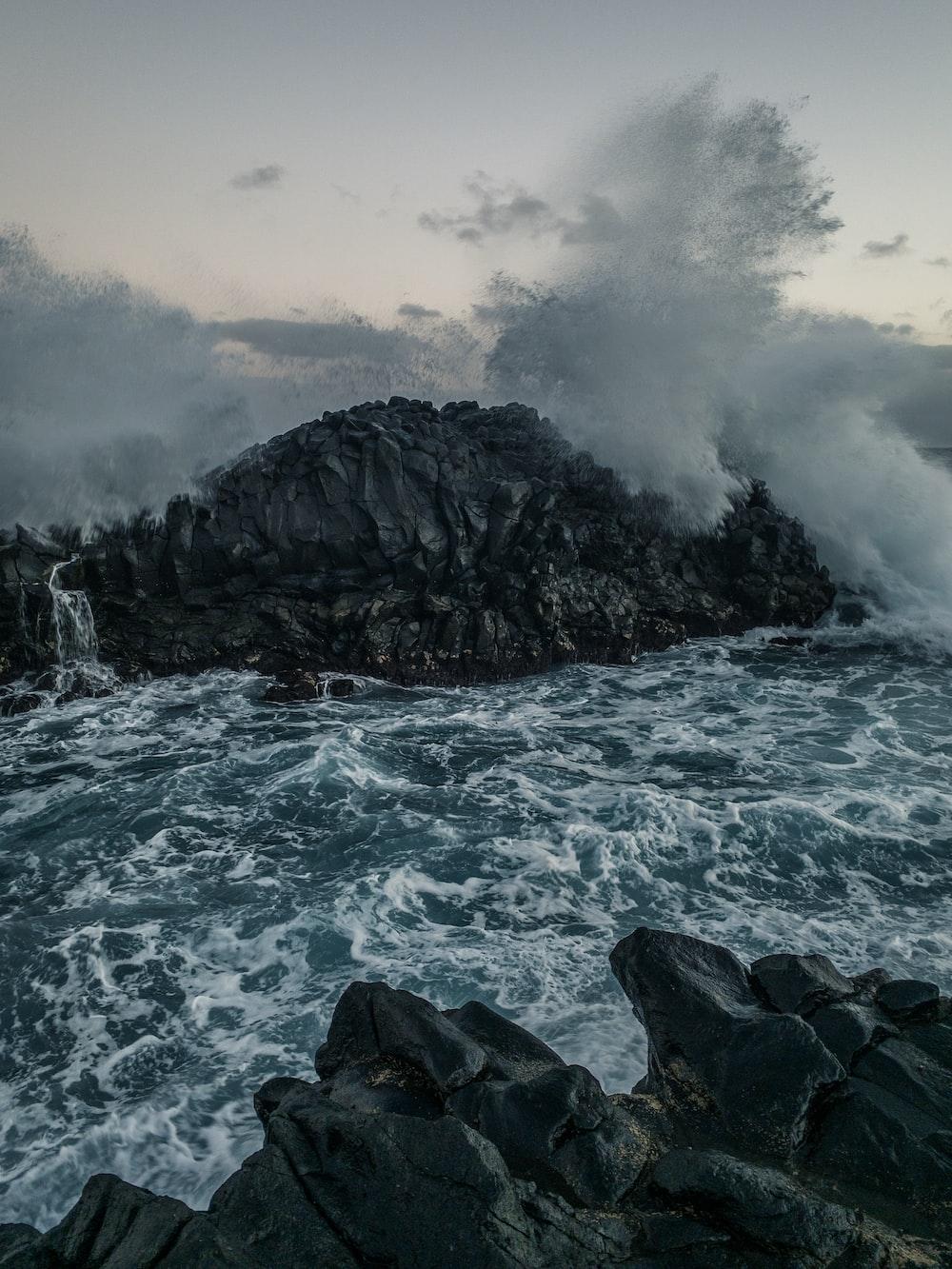 greyscale photography of sea waves
