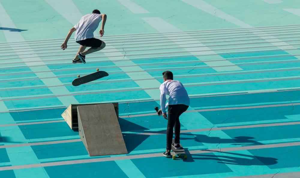 two men playing skateboards