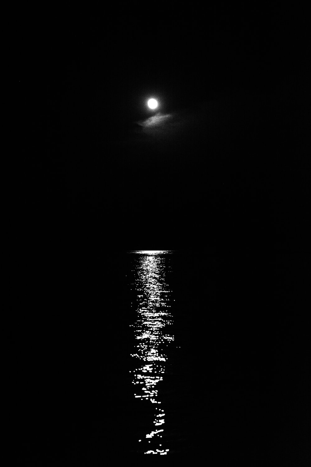 moon above body of water