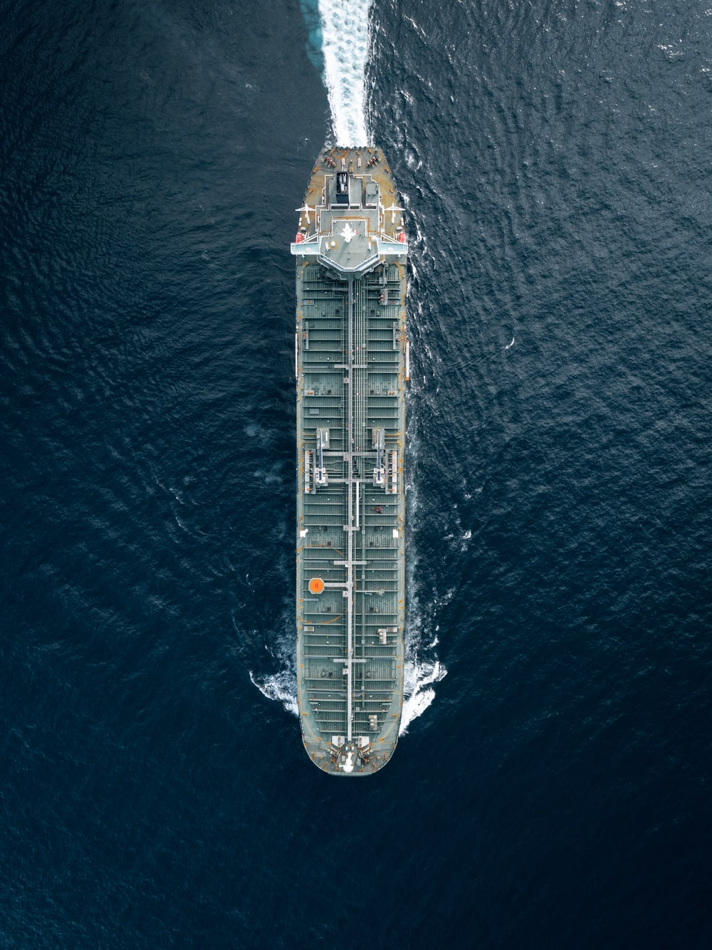 container ship cruising on the middle of the sea