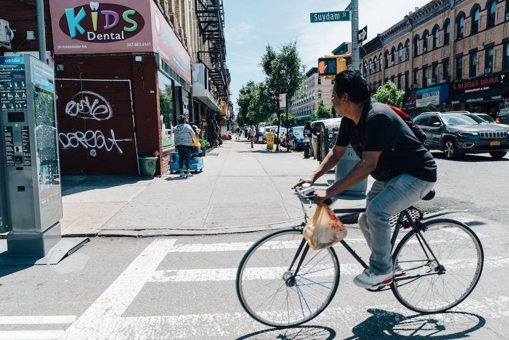 man riding bicycle during daytime