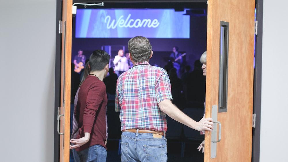 man standing on doorway