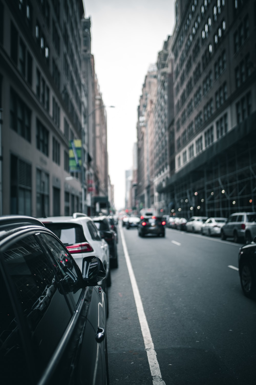 black vehicle parked beside buildings