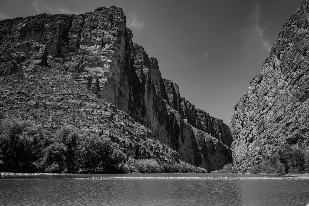 grayscale photography of land formation