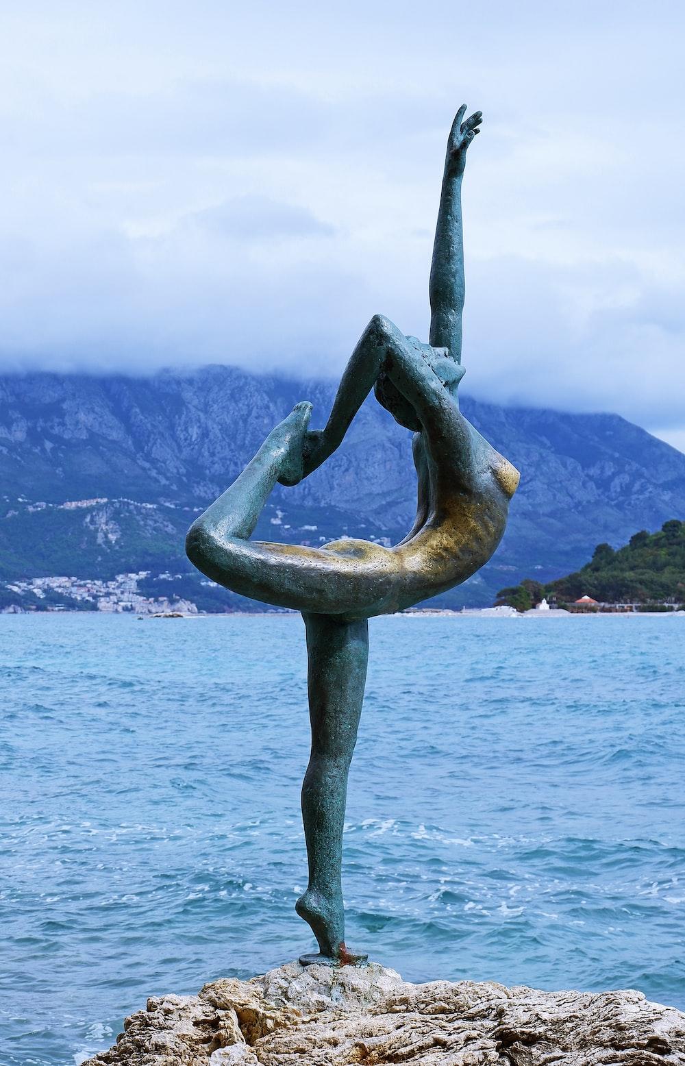 woman doing yoga statue