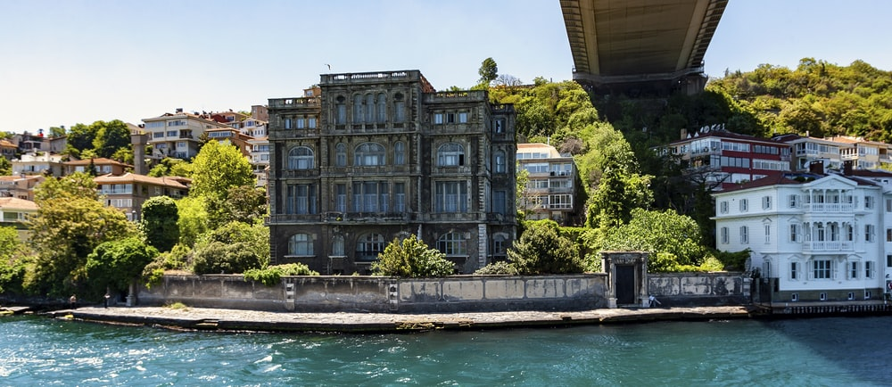 gray concrete building near bridge