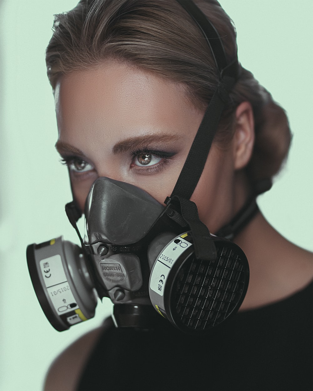 woman wearing gray respirator
