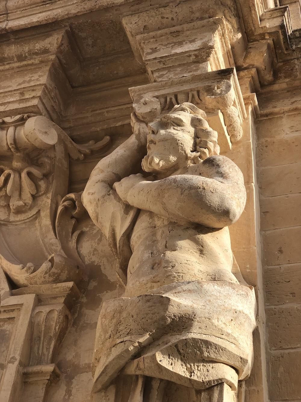 man's sculpture