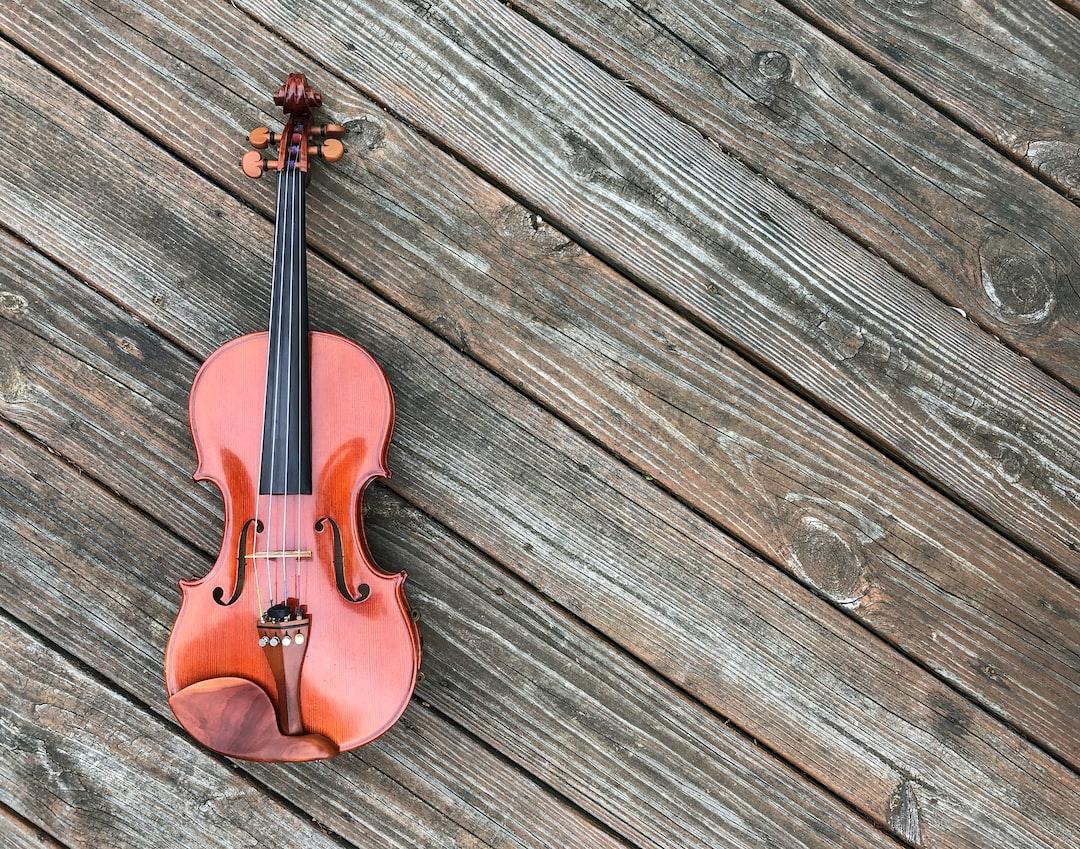 violin set on a rustic wooden deck