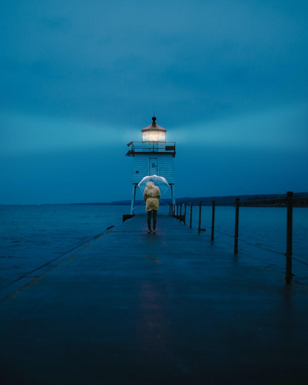 person walking on dock