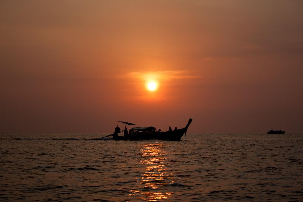 motorboat sailing at sea during sunset