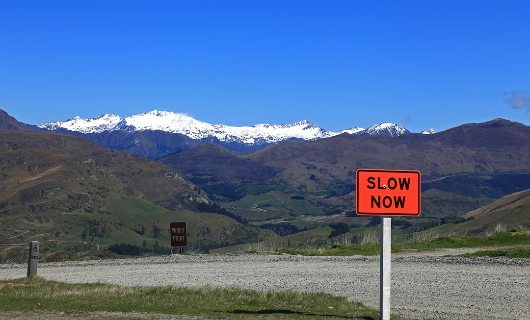 This sign was hard to ignore on the mountain road as the bright orange color screamed against the cool blues of the scene.