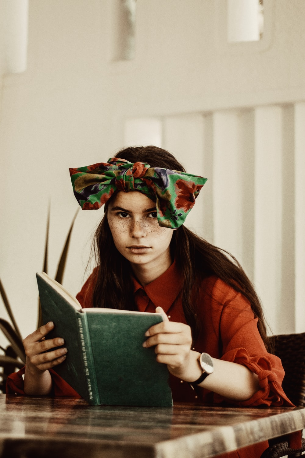 woman holding an open book