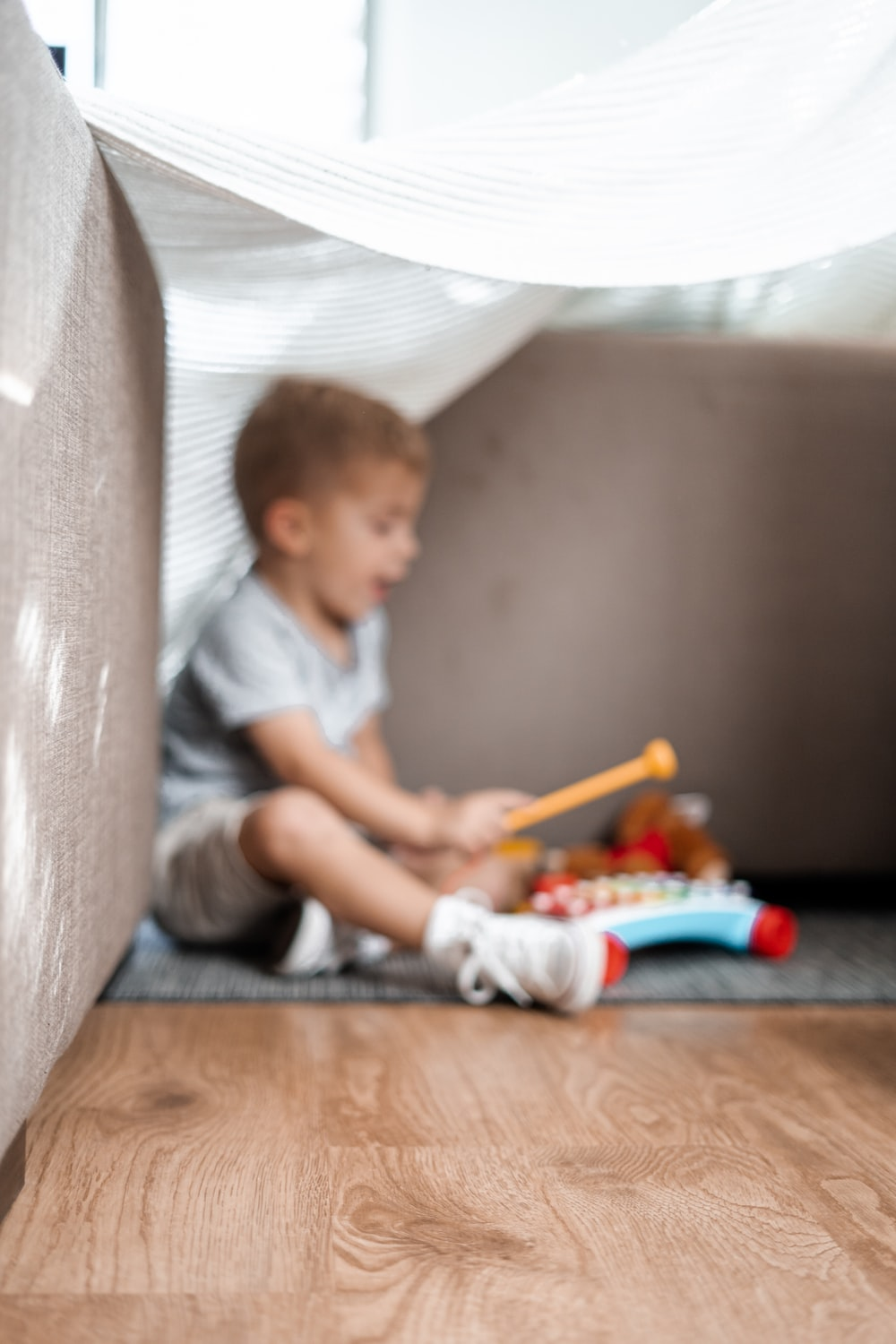 boy playing musical instrument toy