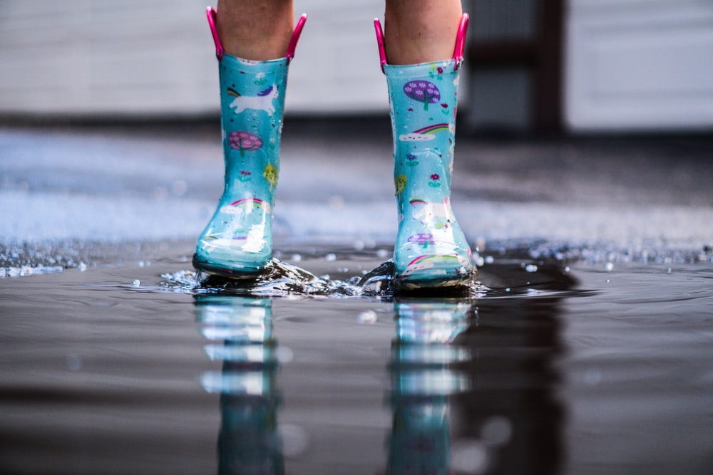 person in blue rain boots