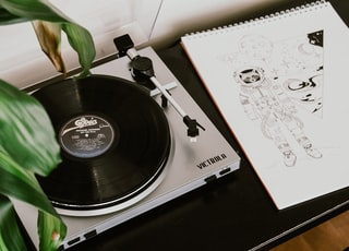 turntable beside sketchpad with astronaut drawing